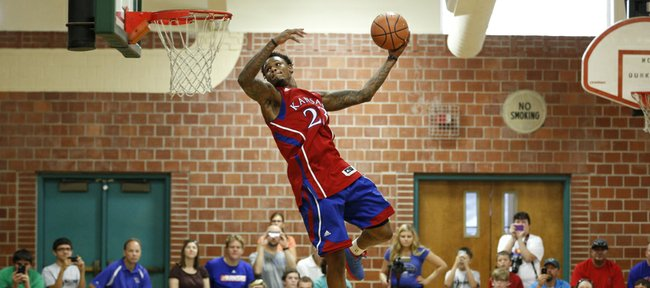 Former Kansas standout Ben McLemore gets airborne for a dunk before fans gathered for the Sir McLemore Summer Slam at the Community Building on Saturday, July 26, 2014. Proceeds from McLemore's charity event will go to fight childhood hunger.