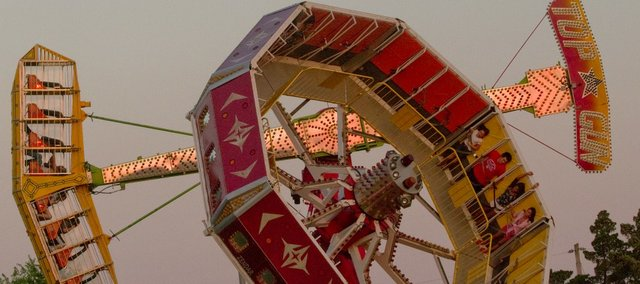 Turn your world upside down at family night at the Douglas County Fair's carnival, 6 to 11 p.m.