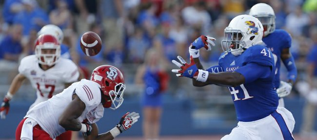 Kansas University tight end Jimmay Mundine (41) can't make the catch during the first half against South Dakota in this file photo from Sept. 7, 2013, at Memorial Stadium.