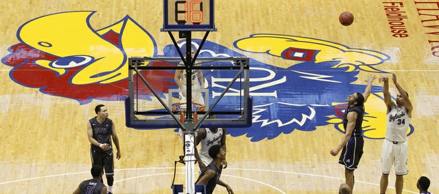 Kansas forward Perry Ellis puts up a shot over TCU forward Amric Fields during the second half on Saturday, Feb. 15, 2014 at Allen Fieldhouse.