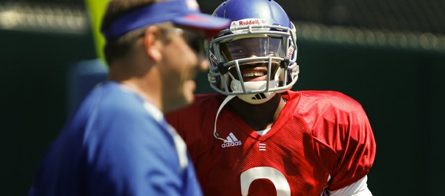 Kansas quarterback Montell Cozart has a laugh with quarterbacks coach Ron Powlus during practice on Monday, August 11, 2014 at the practice fields.