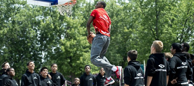 NBA first-overall draft pick Andrew Wiggins goes up for a dunk while shooting a commercial Monday after signing an endorsement deal with BioSteel Sports Drink at his old school in Concord, Ontario.