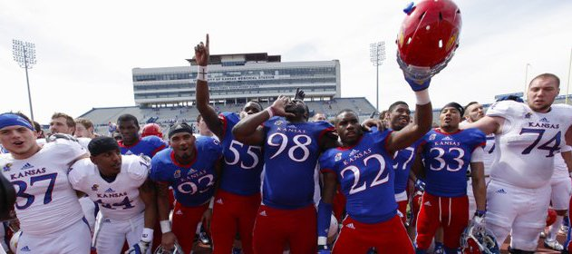 Blue Team defensive lineman Keon Stowers (98) leads the singing of the Alma Mater following the Kansas Spring Game on Saturday, April 12, 2014 at Memorial Stadium. The Blue Team came back from a  first-half deficit to win 20-10. Nick Krug/Journal-World Photo