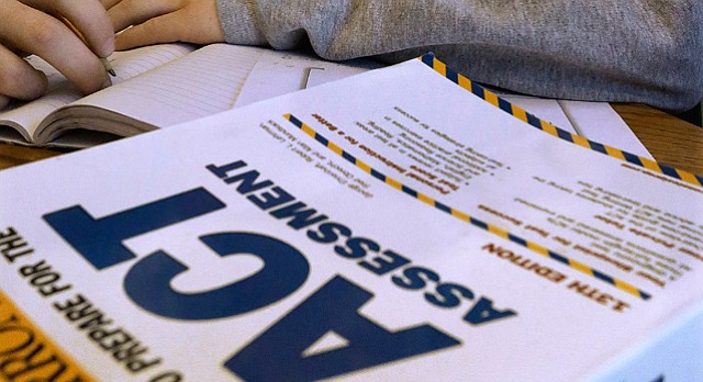 In this April 1, 2014 photo, an ACT Assessment preparation book is seen in Springfield, Ill. (AP Photo/Seth Perlman)