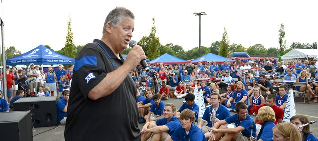 Kansas football coach Charlie Weis speaks to the crowd Friday during the KU kickoff football rally at Corinth Square in Prairie Village.