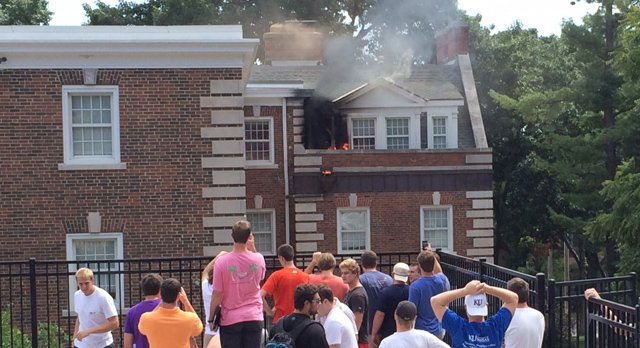 Flames and smoke show on the third floor of the Sigma Chi house, near 14th and Tennessee streets, just before noon on Tuesday, Aug. 26, 2014.