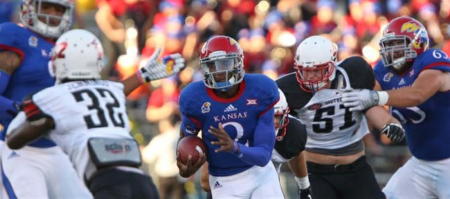 Kansas quarterback Montell Cozart heads up the field on a run against Southeast Missouri State during the first quarter on Saturday, Sept. 6, 2014 at Memorial Stadium.