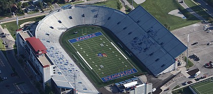 The new turf-covered areas of Kansas University's Memorial Stadium are shown in this aerial photo from Sept. 4, 2014. During the summer, KU removed the running track that surrounded the football field.