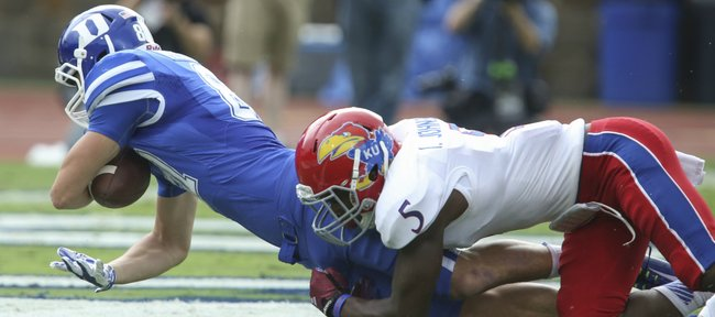 Duke receiver Max McCaffrey falls into the end zone for a touchdown with Kansas safety Isaiah Johnson on his back during the first quarter on Saturday, Sept. 13, 2013 at Wallace Wade Stadium in Durham, North Carolina.