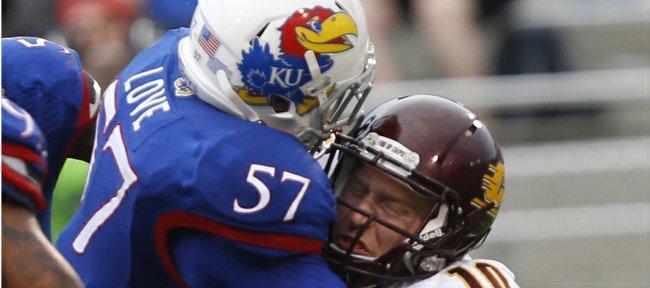 KU's junior linebacker Jake Love puts a big sack on Central Michigan's quarterback  Cooper Rush (10) at Memorial Stadium, as the Hawks came home the winner 24-10.