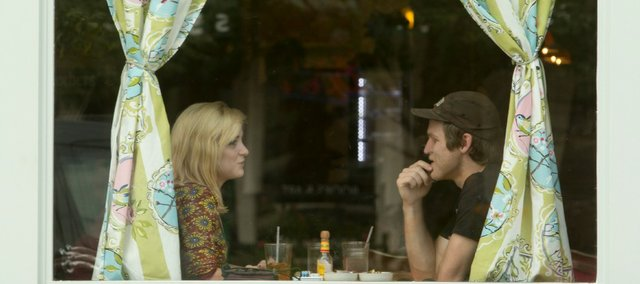 Maddy Roger and Kyle Wedd enjoy a meal in the front window of the The Ladybird Diner, 721 Massachusetts St.