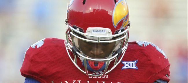 Kansas quarterback Montell Cozart hangs his head after being picked off by a Texas defender during the fourth quarter on Saturday, Sept. 27, 2014 at Memorial Stadium.