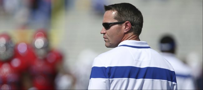 Kansas defensive coordinator Clint Bowen looks out over his defense as the Jayhawks warm up prior to kickoff against Texas on Saturday, Sept. 27, 2014 at Memorial Stadium.