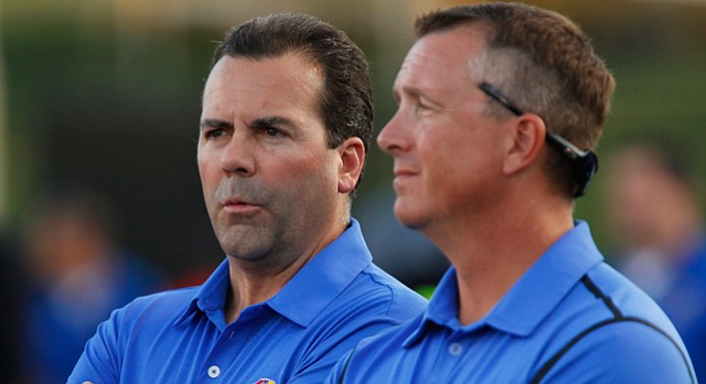 Kansas University director of athletics Sheahon Zenger, left, watches from the sideline next to deputy athletics director Sean Lester during the final minutes on Saturday, Sept. 27, 2014 at Memorial Stadium.