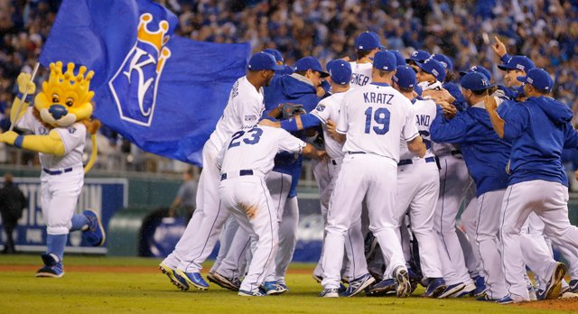 Kansas City Royals players celebrate following Game 3 of baseball's AL Division Series in Kansas City, Mo., Sunday, Oct. 5, 2014. The Kansas City Royals defeated the Los Angeles Angels 8-3 to sweep the series.