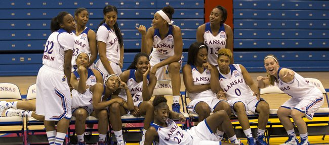 Kansas womens basketball team members pose for a silly team portrait for KU photorapher Jeff Jacobson during the 2014 womens basketball media day Tuesday afternoon at Allen Fieldhouse. The Jayhawks open their season on Nov. 2, 2014 with a home exhibition game against Fort Hays State. The scheduled tip off time is 2 p.m.