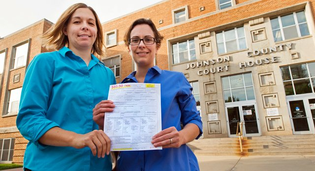 Angela Schaefer, left, and partner, Jennifer Schaefer hold an application for a marriage license at the clerk's office at the Johnson County Courthouse in Olathe, Kan., Wednesday, Oct. 8, 2014. They are due to obtain their license Tuesday, after the weekend and the Columbus Day holiday Monday.