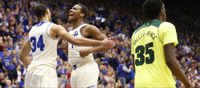 Kansas teammates Perry Ellis (34) and Wayne Selden chest bump before Baylor forward Taurean Prince following a dunk by Ellis and a foul by Baylor forward Cory Jefferson during the second half on Monday, Jan. 20, 2014 at Allen Fieldhouse.
