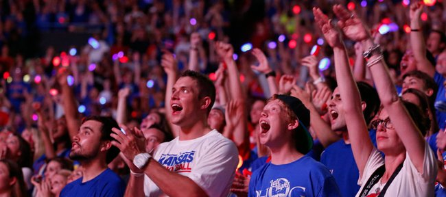 """Fans watching the """"Dream On"""" video get excited after a replay of the Jayhawks' final victory over Missouri in February of 2012 is played during Late Night in the Phog, Friday, Oct. 4, 2013 at Allen Fieldhouse."""