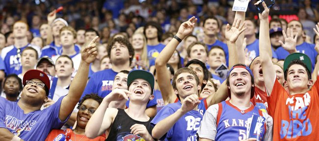 Jayhawk fans look to draw the attention of the cameras during Late Night in the Phog, Friday, Oct. 4, 2013 at Allen Fieldhouse.