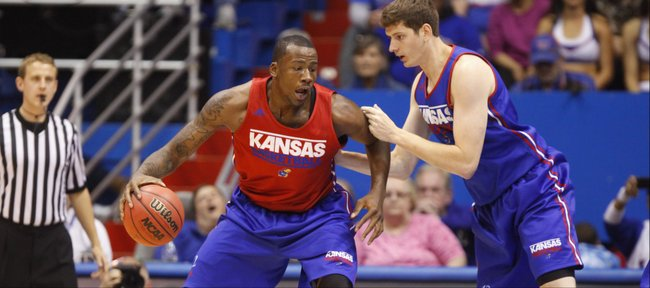 Red Team forward Cliff Alexander works his way into the post against Blue Team forward Hunter Mickelson during the Late Night in the Phog scrimmage on Friday, Oct. 10, 2014 at Allen Fieldhouse.