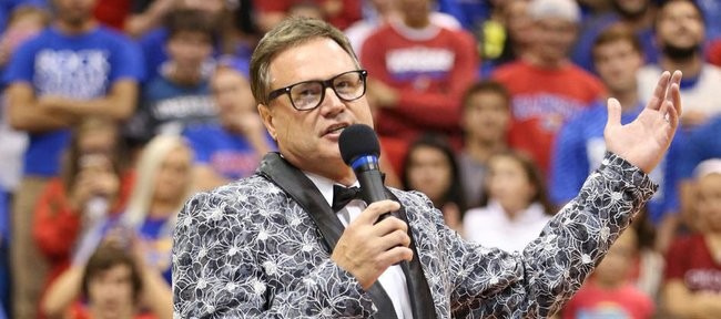 Dressed like number 1 pick Andrew Wiggins from the 2014 NBA Draft, Kansas head basketball coach Bill Self addresses the fieldhouse crowd during Late Night in the Phog on Friday, Oct. 10, 2014.