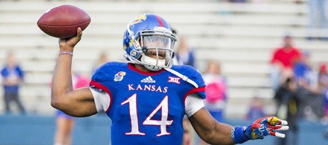 Kansas junior quarterback Michael Cummings unleashes a pass during Kansas' game against Oklahoma State Saturday at Memorial Stadium.