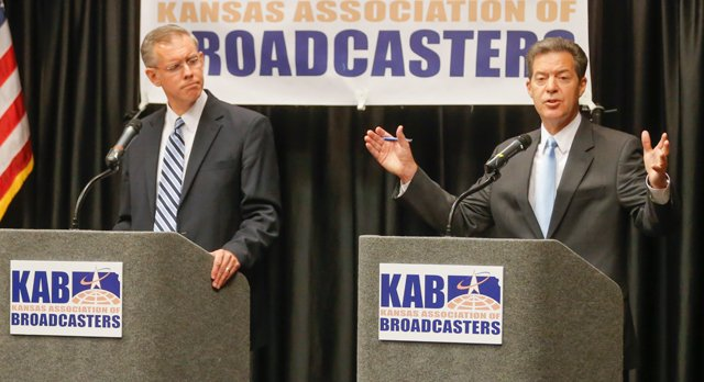 a discussion on the kansas governor race between sam brownback and paul davis Davis narrowly lost to incumbent republican sam brownback in the 2014 race for governor davis is from lawrence and served as the democratic leader in the kansas house of representatives.