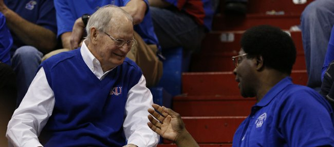 Former Kansas head coach Ted Owens chats it up with former player Tommie Smith on Saturday, Feb. 8, 2014 at Allen Fieldhouse. Owens' 1974 Final Four team was honored during the first half of Saturday's game.