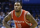 Houston Rockets' Tarik Black (10) looks to pass the ball against the Orlando Magic during the first half of an NBA preseason basketball game in Orlando, Fla., Wednesday, Oct. 22, 2014.