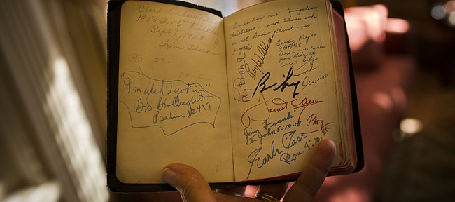 Clark Talley, Lawrence resident, 70, first had his Bible signed by Phog Allen in the mid-50s. Since then, he has managed to add signatures from Bill Self, and most recently, Ted Owens, Larry Brown and Roy Williams last Monday at the 60 years of Allen Fieldhouse celebration.