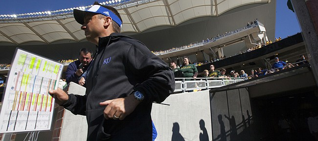 Kansas co-offensive coordinator Eric Kiesau runs out to the field before kickoff against Baylor on Saturday, Nov. 1, 2014 in Waco, Texas.
