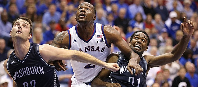 Kansas forward Cliff Alexander works between Washburn players Alex North (22) and Kevin House during the second half on Monday, Nov. 3, 2014 at Allen Fieldhouse.