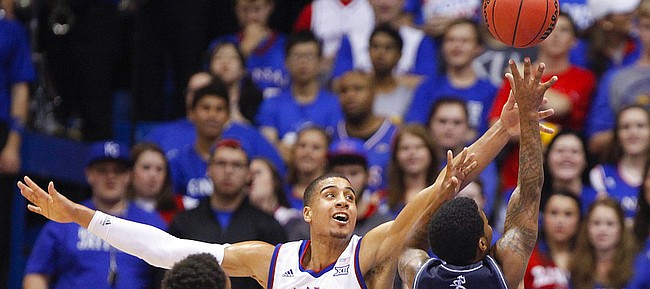 Kansas forward Landen Lucas defends against a shot from Washburn guard Kevin House during the second half on Monday, Nov. 3, 2014 at Allen Fieldhouse.