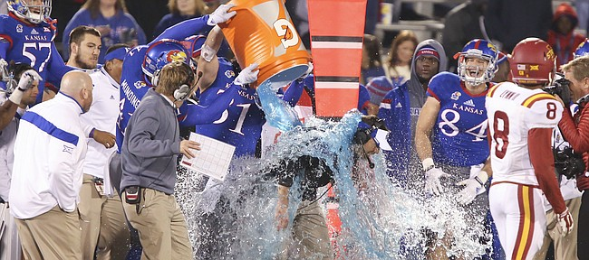 Kansas interim head football coach Clint Bowen gets doused in a Gatorade bath in the final seconds of the Jayhawks' 34-14 win over Iowa State on Saturday, Nov. 8, 2014.