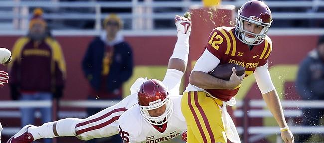 Iowa State quarterback Sam B. Richardson (12) runs from Oklahoma linebacker Jordan Evans in this photo from Saturday in Ames, Iowa. Richardson and the Cyclones will take on Kansas University on Saturday at Memorial Stadium.