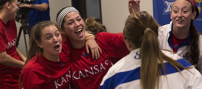 Kansas University seniors Kelsey Lyden and Ali Kimura celebrate their NCAA Soccer Tournament invitation after a watch party on Monday, Nov. 10, 2014, at Rock Chalk Park. KU will open the tourney against Missouri on Sunday at RCP.