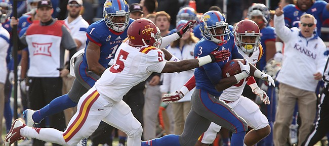 Kansas running back Tony Pierson gets up the field past Iowa State defenders Kamari Cotton-Moya (5) and Nigel Tribune, back, during the first quarter on Saturday, Nov. 8, 2014.