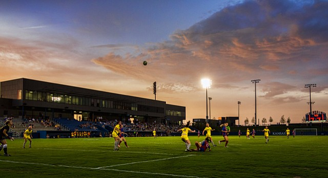 Kansas opened its 2014 soccer season against Wyoming under the lights at its new home, Rock Chalk Park on Friday evening.
