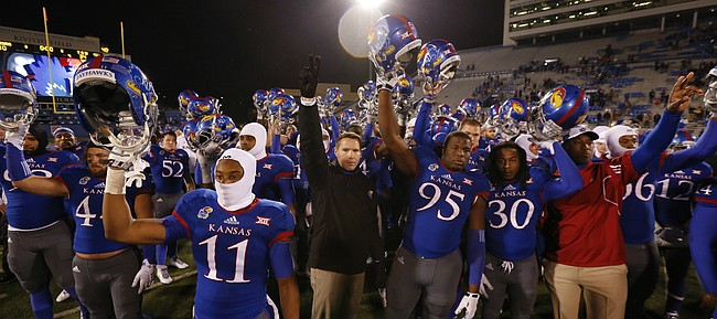 Kansas interim head football coach Clint Bowen stops to salute the student section and the Jayhawk fans remaining after their heartbreaking 34-30 loss to TCU on Saturday, Nov. 15, 2014 at Memorial Stadium.