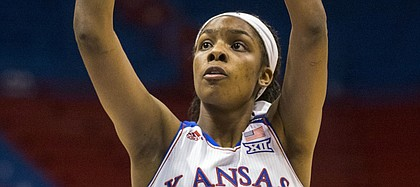 Kansas senior forward Chelsea Gardner scores one of her game high 24 points during the second half of Kansas' game against South Dakota Sunday afternoon at Allen Fieldhouse. The Jayhawks held off the Coyotes, 68-60, for a season opening victory. Despite being in foul trouble for much of the game, Gardner's 24 points put her in the 1,000 career points club at KU.