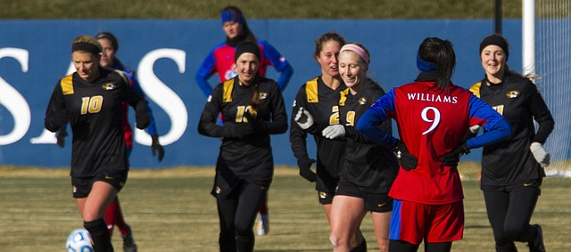 Kansas junior forward Ashley Williams (9) can only watch as Missouri players celebrate a goal during their first round NCAA soccer match Sunday at Rock Chalk Park. The Jayhawks fell to the Tigers, 3-1, ending their season.