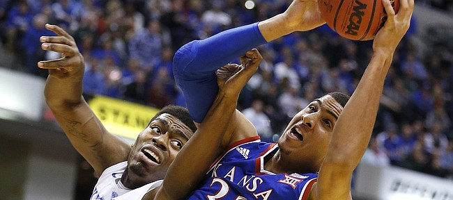 Kansas forward Landen Lucas (33) grabs a rebound from Kentucky center Dakari Johnson (44) during the first half of the Champions Classic on Tuesday, Nov. 18, 2014 at Bankers Life Fieldhouse in Indianapolis.