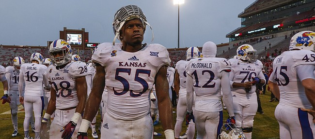 Kansas linebacker Michael Reynolds looks in the direction of the scoreboard while he and his teammates gather to leave the field following the Jayhawks' 44-7 loss to the Sooners on Saturday, Nov. 22, 2014 at Memorial Stadium in Norman, Oklahoma.