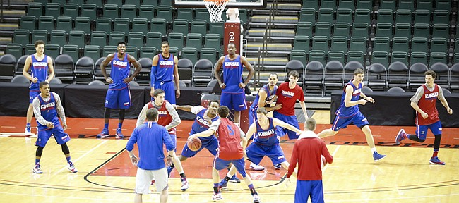 The Jayhawks work through defensive drills during practice on Wednesday, Nov. 26, 2014 at the HP Fieldhouse in Kissimmee, Florida.