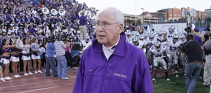 Kansas State head coach Bill Snyder leads his Wildcats on to the field before taking on Kansas Thursday, Oct. 14, 2010 at Memorial Stadium.