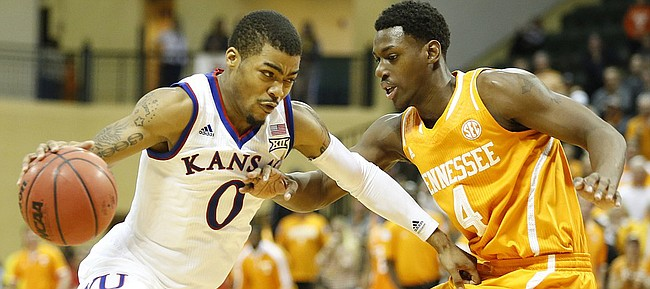 Kansas guard Frank Mason III (0) looks to drive against Tennessee forward Armani Moore (4) during the second half on Friday, Nov. 28, 2014 at the HP Field House in Kissimmee, Florida.
