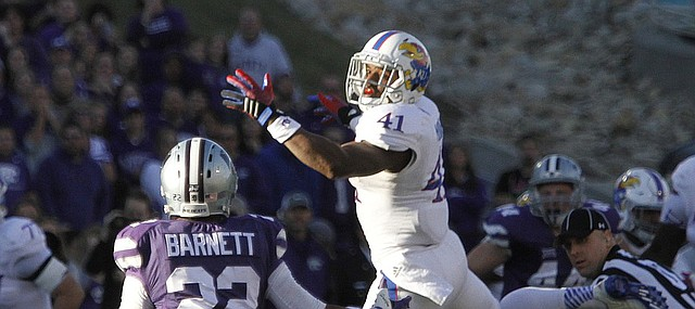 After an attempted catch, Kansas wide receiver Jimmay Mundine (41) tips the ball toward Wildcat cornerback Dante Barnett (22) who made the interception in the Jayhawks game against the Kansas State Wildcats Saturday in Manhattan. .