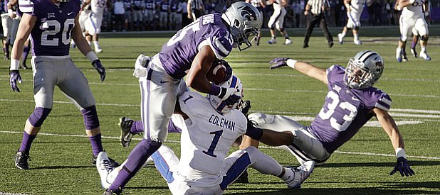 Kansas State defensive back Randall Evans, grabs an interception off a tapped ball by KU receiver Rodriguez Coleman, (1)  in the Jayhawks game against the Kansas State Wildcats Saturday in Manhattan. At left is KSU defender Morgan Burns, (33)..
