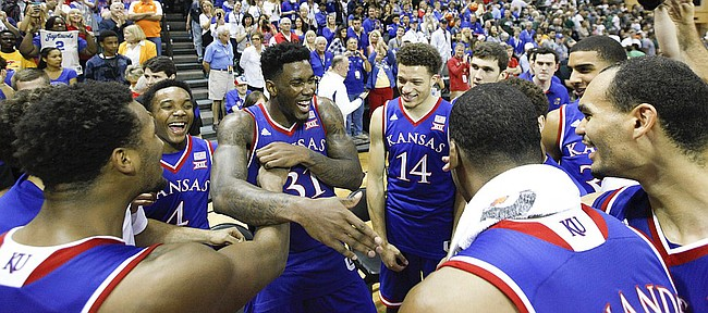 Kansas forward Jamari Traylor (31) is surrounded by his teammates after the Jayhawks' win over Michigan State  during the championship of the Orlando Classic on Sunday, Nov. 30, 2014 at the HP Field House in Kissimmee, Florida.